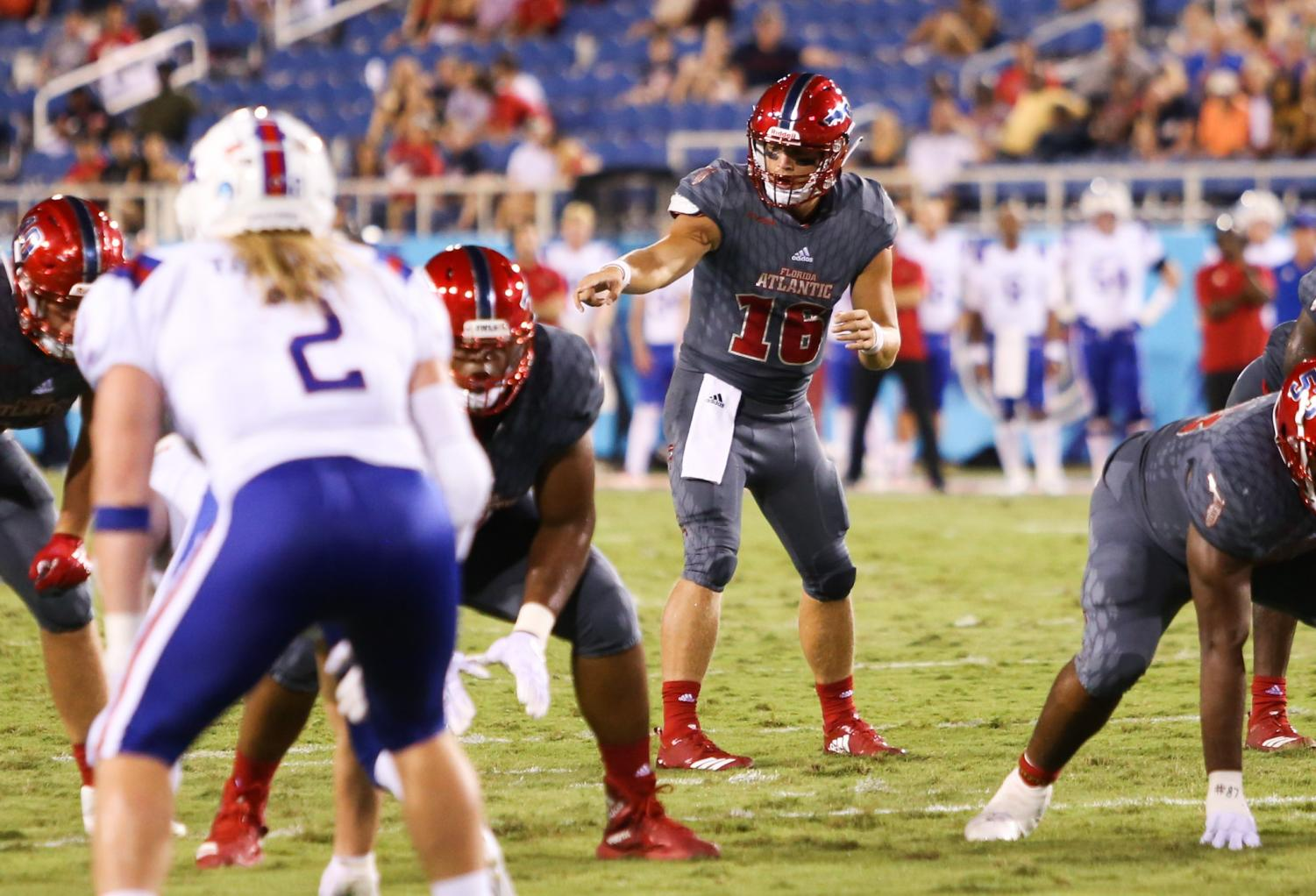 FAU graduate student quarterback Rafe Peavey (16), who was the starting quarterback against LA Tech signals to his teammates to prepare for play. Photo by: Alexander Rodriguez