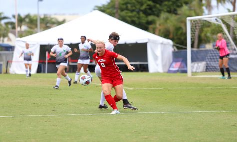 FAU junior defense Ebba Blomqvist (9) attempts to regain possession of the soccer ball while North Texas attempts to defend her goal area. Photo by Alex Rodriguez