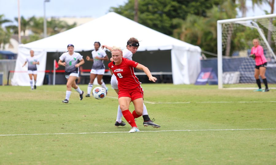 FAU+junior+defense+Ebba+Blomqvist+%289%29+attempts+to+regain+possession+of+the+soccer+ball+while+North+Texas+attempts+to+defend+her+goal+area.+Photo+by+Alex+Rodriguez%0A