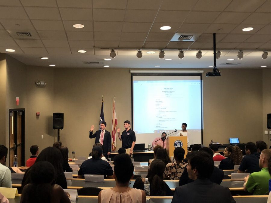 Noah Goldberg (left) was sworn in at the first Boca House of Representatives meeting Friday. Photo by Sophie Siegel