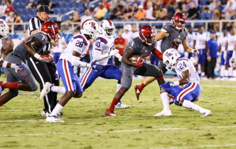 FAU redshirt junior running back Kerrith Whyte Jr. (6) attempts to side step against a LA Tech defensive player. Photo by: Alexander Rodriguez