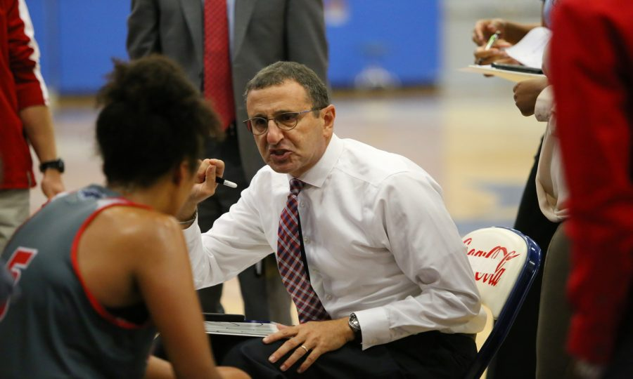 FAU women's basketball head coach Jim Jabir talks next tactics with his players during a media timeout. Photo by Alex Rodriguez