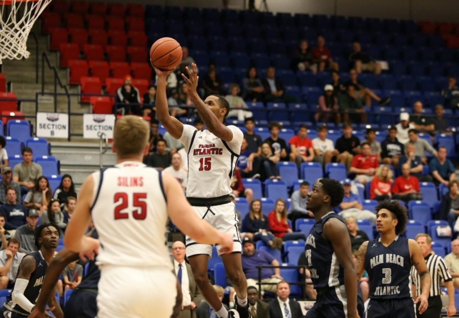 FAU junior forward Jailyn Ingram (15) attempts to dunk the ball into the net during the first half of the match against Palm Beach Atlantic University. Photo by: Alexander Rodriguez