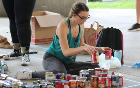Homecoming week event collects canned food for charity