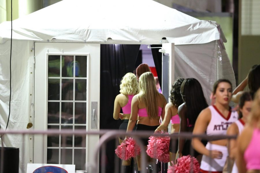 Over 50 cheerleaders and dancers share this pop-up tent, which works as a make-shift locker room. Photo by Alexander Rodriguez.