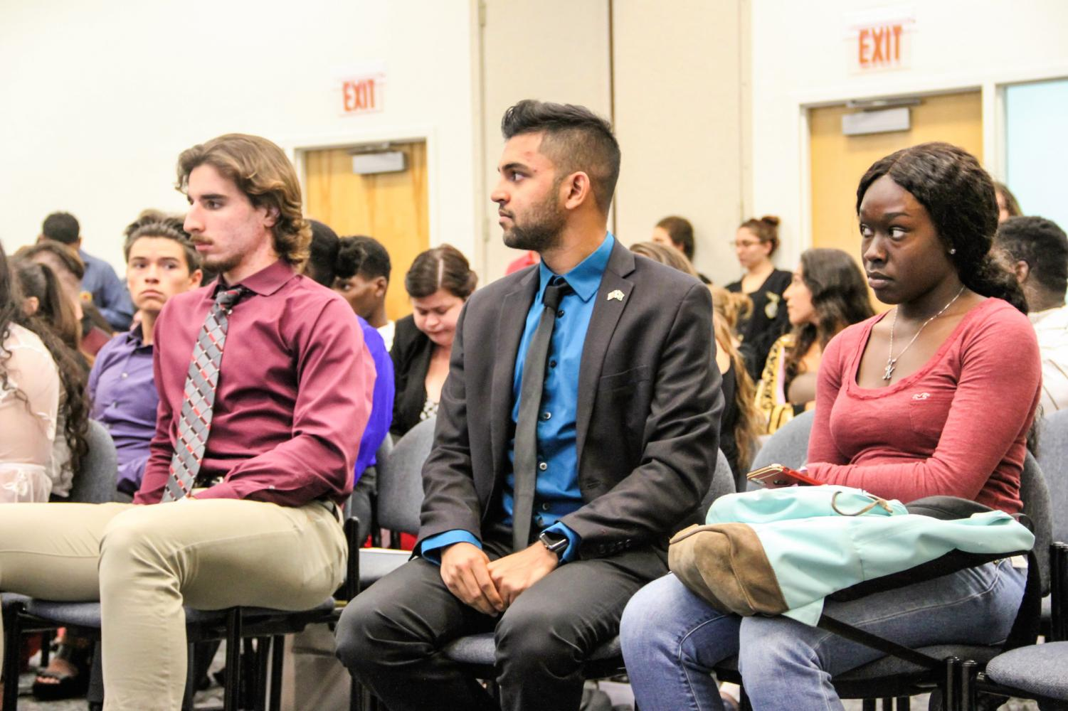 Sayd Hussain (middle) sits next to Boca campus House Rep. Louis Akra during Gov. Luke Turner's impeachment hearing on Nov. 16. Photo by Hope Dean