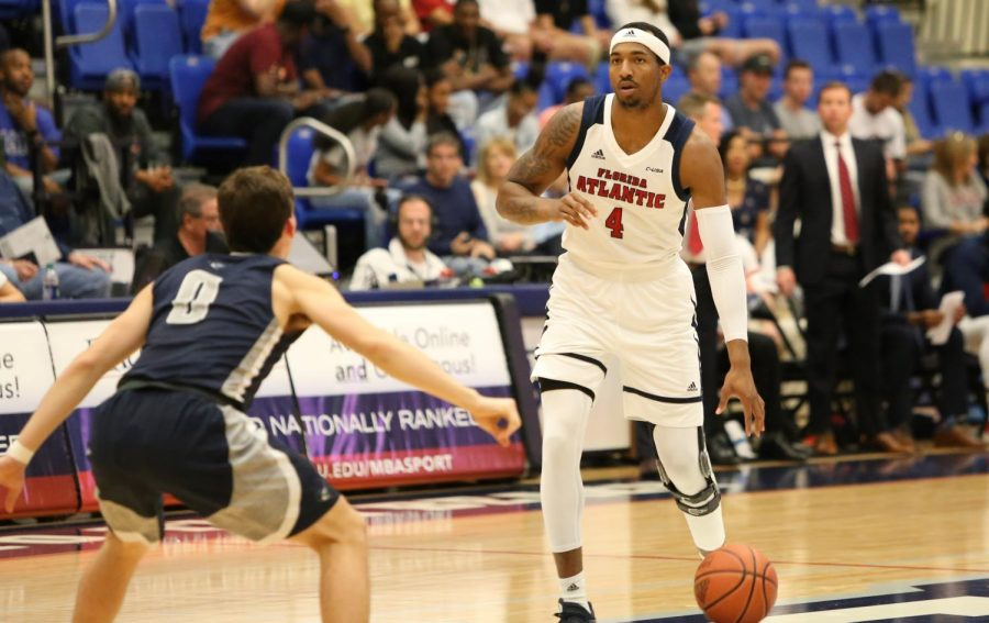 FAU graduate forward Xavian Stapleton (4) attempts to run down court after Palm Beach Atlantic scored a two-pointer. Photo by: Alexander Rodriguez