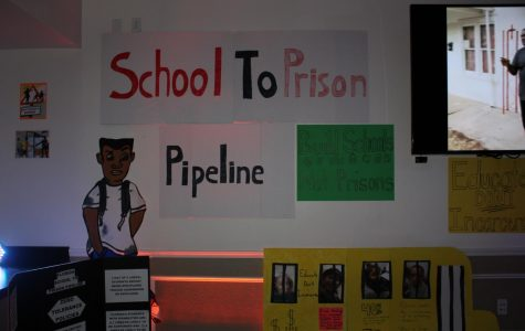 The exhibits were held in a dark room, and one was on the school-to-prison pipeline, or the tendency for minorities to be incarcerated because of harsh school policies. Photo by Makayla Purvis