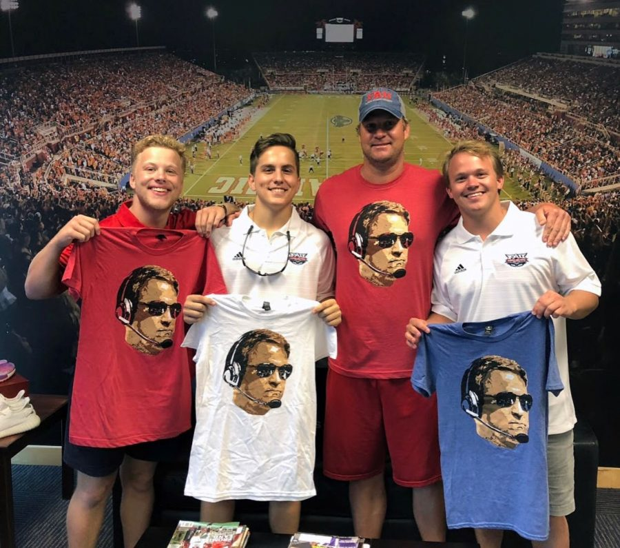 Kiffin+%28center+right%29+poses+with+fans.+Photo+courtesy+of+Head+Coach+Tees+on+Instagram
