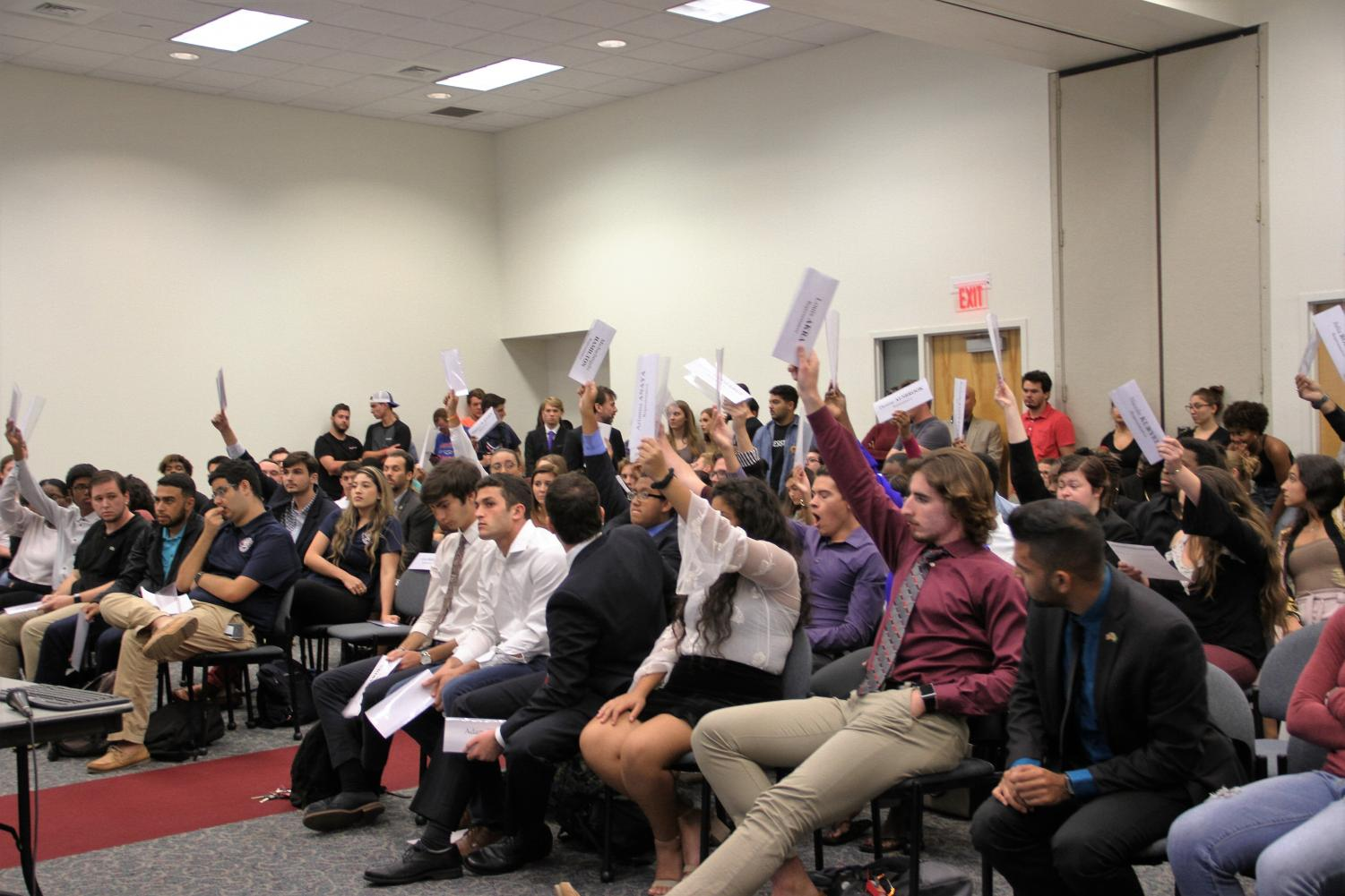The Boca House of Representatives vote on a proposal during a House meeting, similar to how students will be voting for who will represent them in Student Government later this month. Photo by Hope Dean