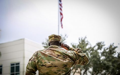 Captain Shantel Glass salutes the flag. He is a military science professor at FAU. Photo by Alex Rodriguez