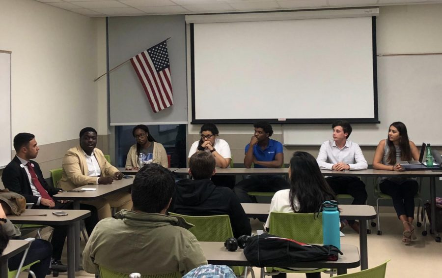 The presidential and governor candidates gathered in a room to answer College Democrats President Matthew Taudien's questions about their platforms. Photo by Cameren Boatner