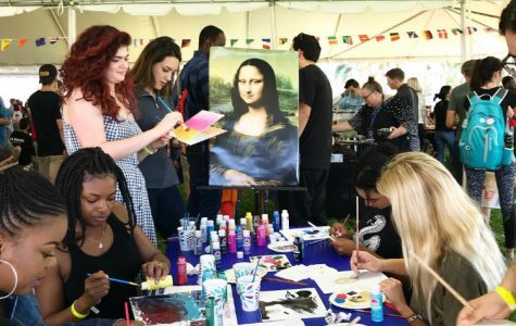 Inside the Festival of Nations' tent that was lined with flags from different countries, students attempted to recreate the famous Mona Lisa painting by Italian artist Leonardo da Vinci. Photo courtesy of FAU Graduate College's Twitter
