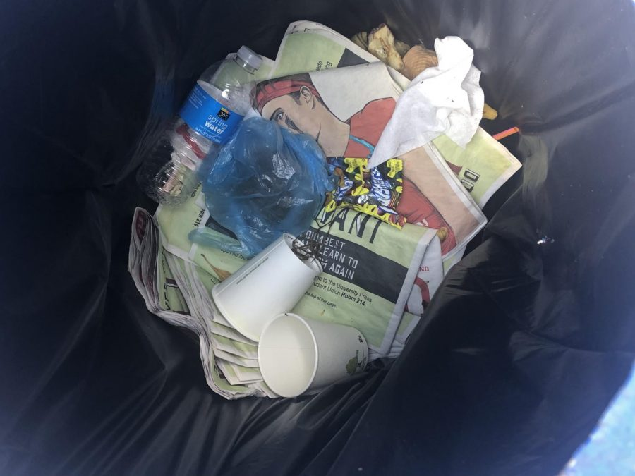 A stack of our most recent issue in the garbage on Diversity Way. Photo by Kristen Grau