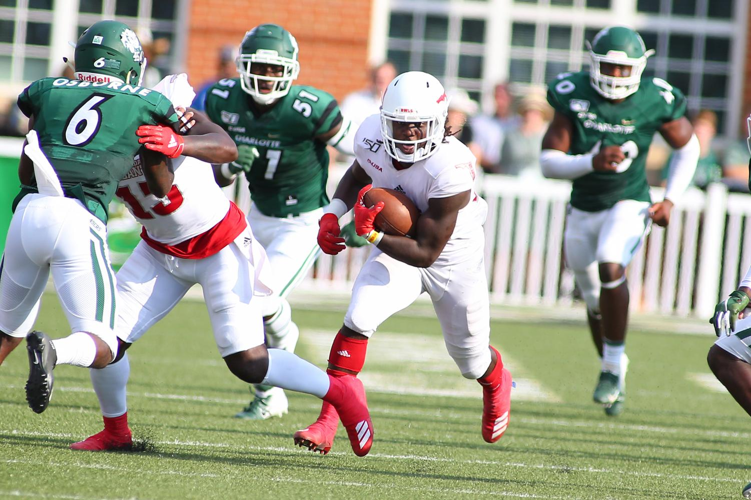 Running back Malcolm Davidson ran the ball effectively against Charlotte with 83 rushing yards and two touchdowns. Photo courtesy of FAU Athletics.