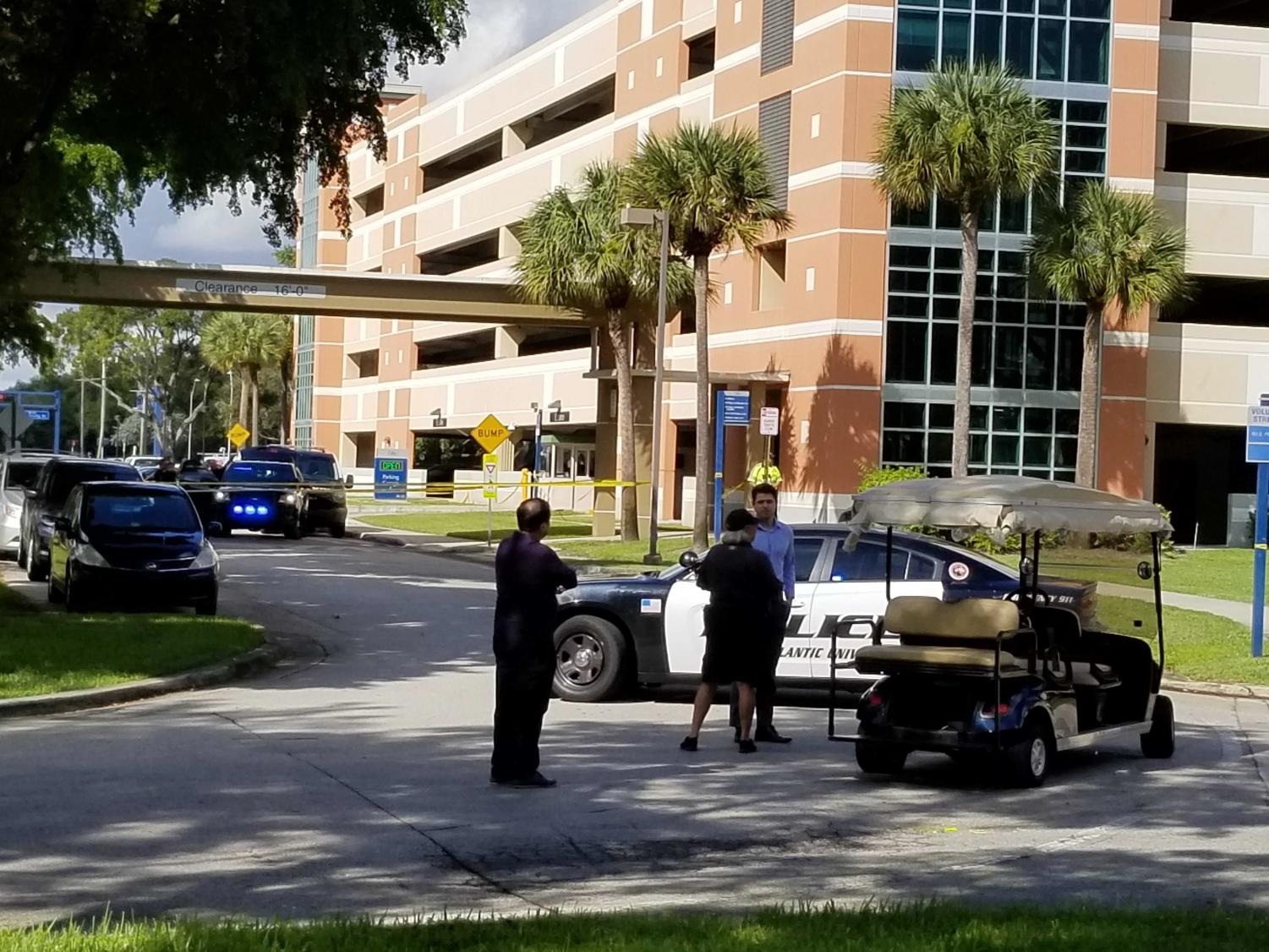 Police responding to the death on campus Tuesday morning. Photo by Kimberly Swan