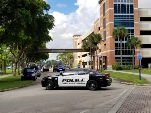 Death near parking garage causes blockage
