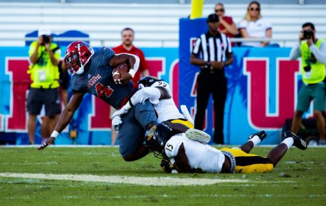 The FAU running attack lead by BJ Emmons rushed for 71 yards and a touchdown while averaging 6.5 yards per carry. Photo by: Alex Liscio.