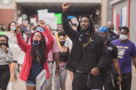Cara Simpson (Left) and Cordel Littlejohn (Right) were just two of the many student-athletes who attended the protest Thursday. Photo by Alex Liscio.
