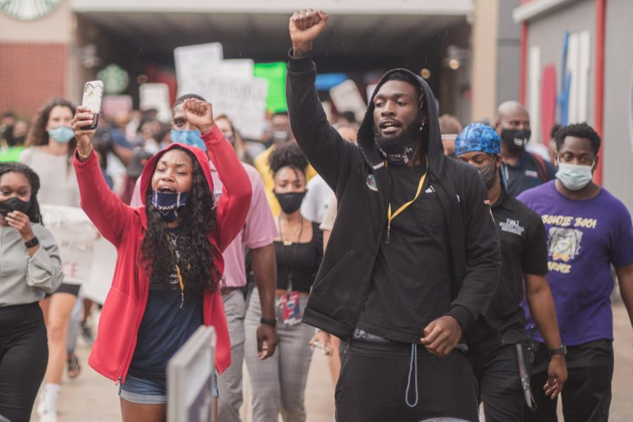 FAU women's track and cross country athlete Cara Simpson (left) and FAU Football quarterback Cordel Littlejohn (right) were just two of the many student-athletes who attended the protest on September 10, 2020 in Boca Raton, FL. Photo by Alex Liscio.