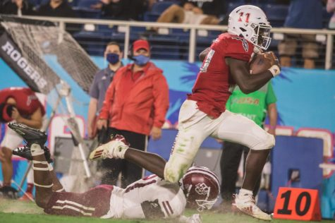 Quarterback Javion Posey rushes for a 70-yard touchdown in the third quarter of FAU