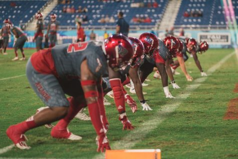 FAU's defensive line warms up before last weeks game against Western Kentucky. Photo by Alex Liscio.