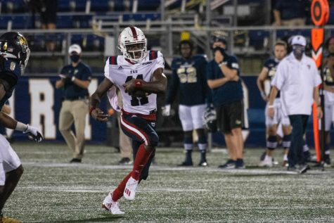 Quarterback Javion Posey broke the FAU record for rushing yards by a quarterback with 182 yards in the Owls' 38-19 win over FIU. Photo Courtesy of FAU Athletics.