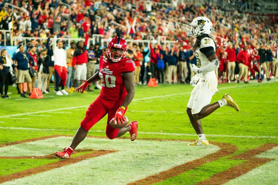 Running back Malcolm Davidson scores a touchdown in last years Shula Bowl. Photo by Alex Liscio.