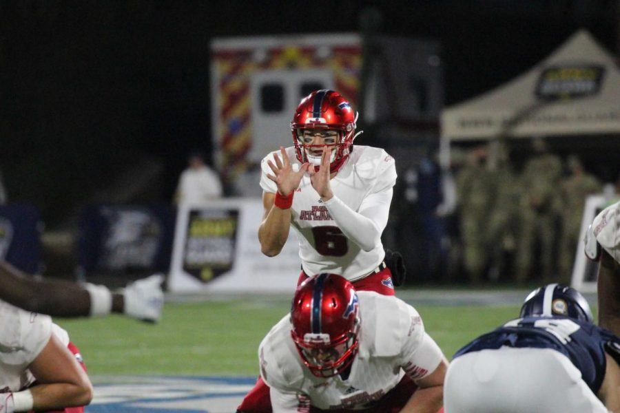 Nick Tronti takes a snap in FAU's loss to Georgia Southern on Dec. 5. Photo Courtesy of FAU Athletics.
