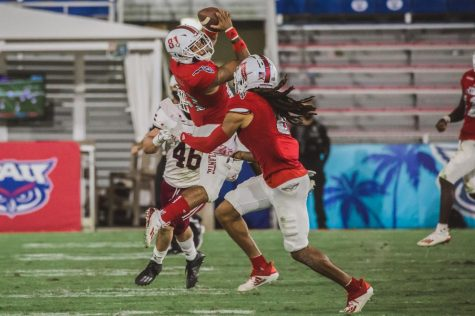 Wide receiver Jordan Merrell makes a leaping catch against UMass on Nov. 20. Photo by Alex Liscio.