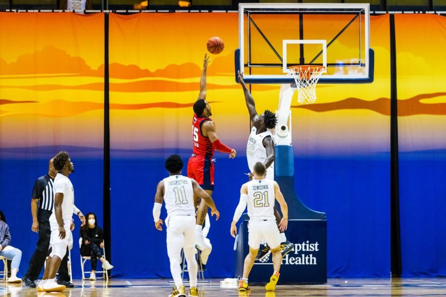 Jailyn Ingram (pictured red, #15) goes up for a shot against FIU. Photo courtesy of FAU Athletics.