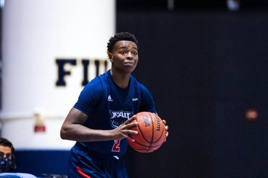 Iggy Allen (pictured #2) had 15 points and 17 rebounds in the loss to FIU. Photo courtesy of FAU Athletics.