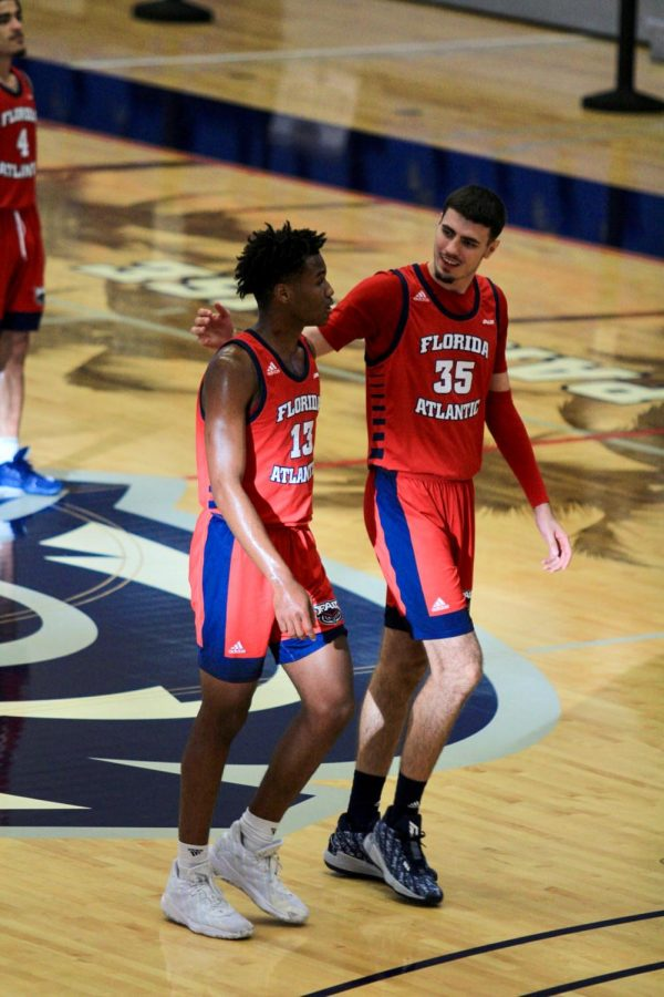 Kenan Blackshear (13) and Dardan Kapiti (35) talk during FAU's 74-71 loss to Charlotte on Jan. 23, 2021. Photo by Eston Parker III.