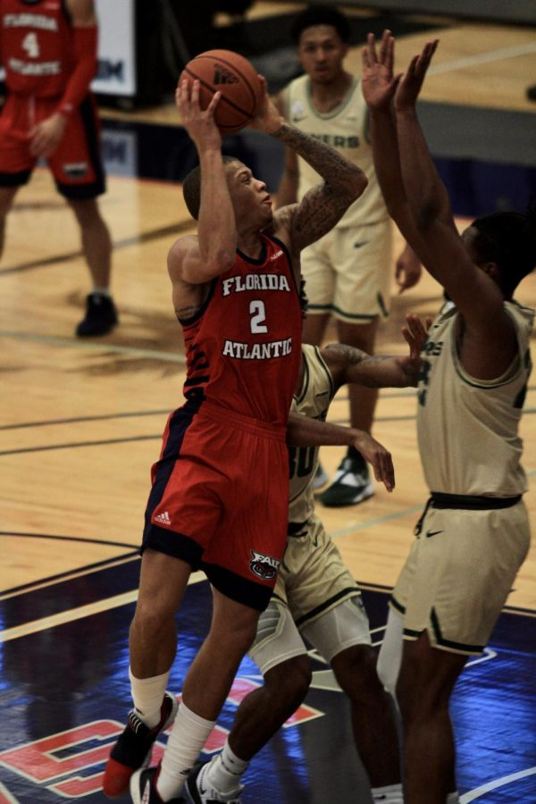 Everett Winchester attempts a shot during FAU's 74-71 loss to Charlotte on Jan. 23, 2021. Photo by Eston Parker III.