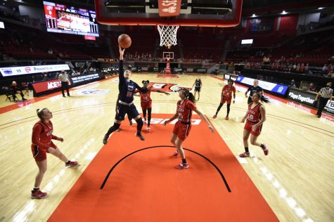 Janeta Rozentale (pictured blue, #30) goes up for a layup against Western Kentucky. Photo courtesy of FAU Athletics.