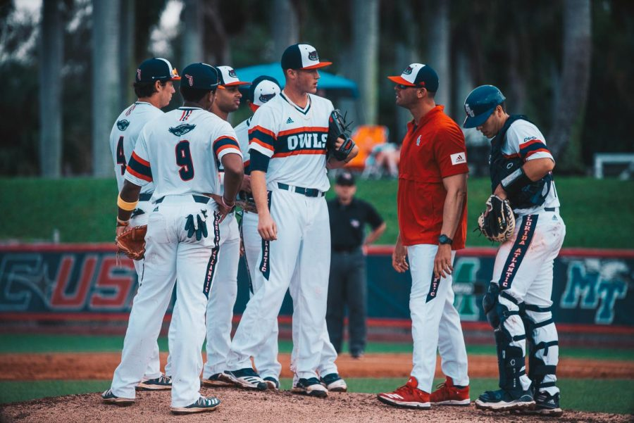 The infielders gather for a mound visit in the middle of an FAU baseball game. Photo by Alex Liscio.