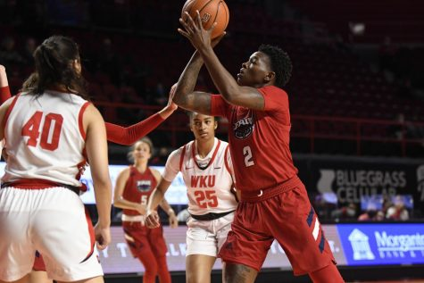 Iggy Allen (pictured red, #2) scored a career-high 35 points in the loss to Western Kentucky. Photo courtesy of FAU Athletics.