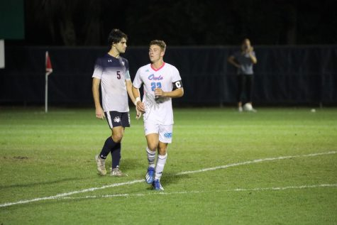 Blake Dean (pictured white, #22) scored the game-tying goal for FAU. Photo courtesy of FAU Athletics.