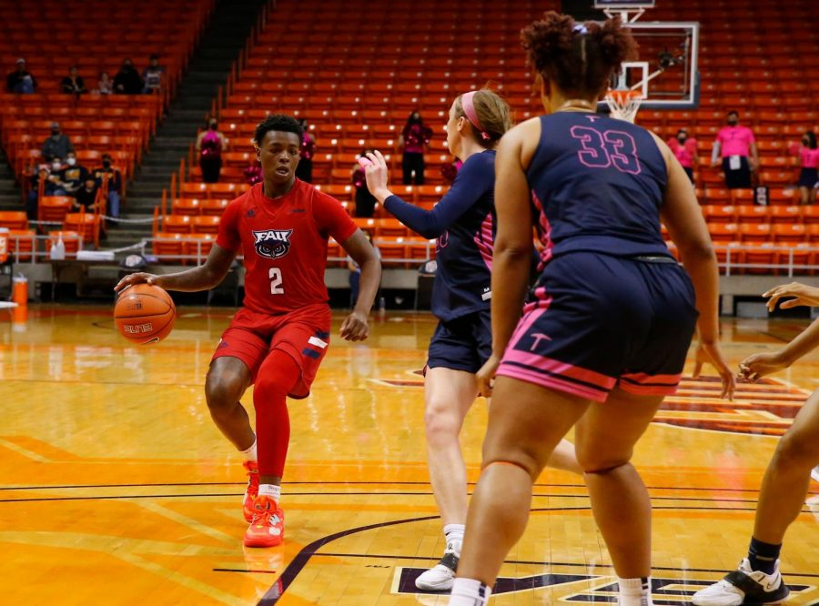 Iggy Allen (pictured red, #2) had a double-double of 28 points and 17 rebounds in the win over UTEP. Photo courtesy of FAU Athletics.