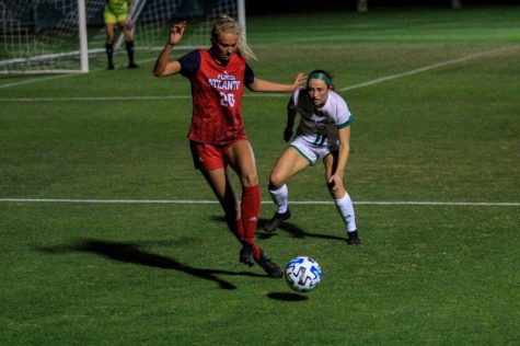 Thelma Hermannsdottir (pictured red, #20) committed a foul in the first half against Florida Gulf Coast. Photo by Eston Parker III.