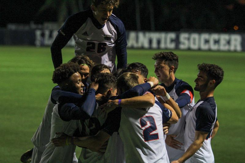FAU men's soccer celebrates its lone goal against North Florida. Photo by Eston Parker III.