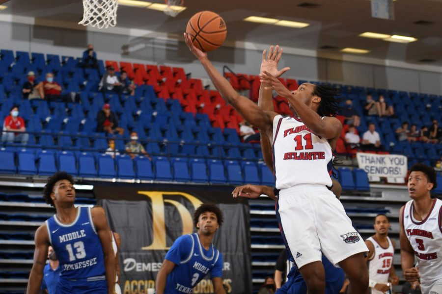 Michael Forrest (pictured #11) goes up for a layup  in Friday's game against Middle Tennessee. Photo courtesy of FAU Athletics.