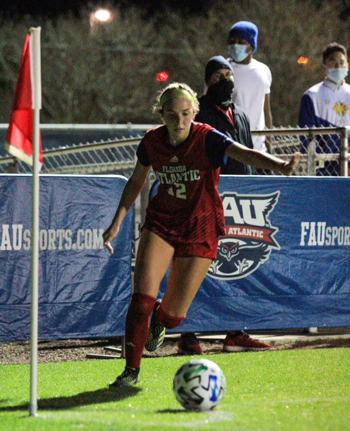 Emma+Grissom+%28pictured+%2312%29+had+an+assist+in+Friday%27s+win+over+Marshall.+Photo+by+Eston+Parker+III.
