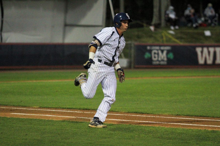 Wilfredo Alvarez runs to home plate against Indiana State on March 13, 2021. Photo by Eston Parker III.