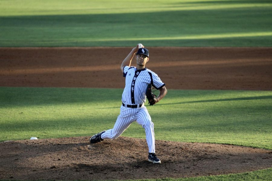 Jackson Spiller throws to the plate against Florida Golf Coast on March 5, 2021. Photo by Eston Parker III.