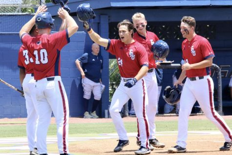 Mitchell Hartigan celebrates with teammates after hitting a grand slam against FIU in Game 1 on May 1, 2021. Photo courtesy of Noah Goldberg.