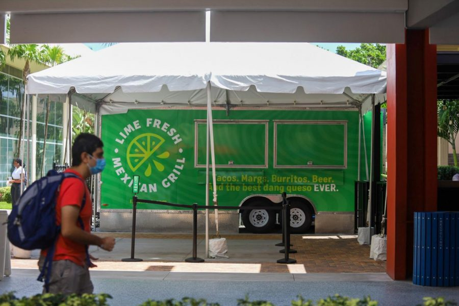 A student walks by Lime Fresh Mexican Grill at the Boca Raton FAU Campus. Lime Fresh is the latest food option on campus. Photo by Eston Parker III.