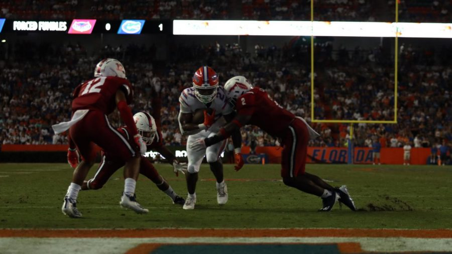 Akileis Leroy (pictured red #2) makes a goal line stop against Florida on Sept. 4, 2021. Photo by Eston Parker III.