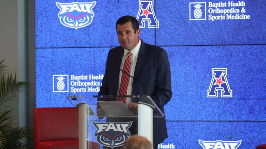 Brian White speaks to the audience at the podium regarding FAUs acceptance to the AAC.