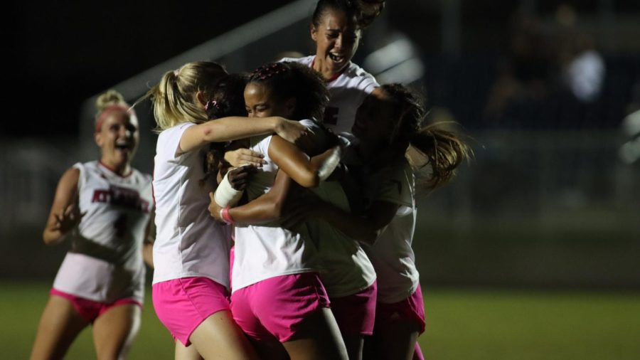 Mia Sennes celebrates with teammates after scoring the game-winning goal against Marshall on Oct. 15, 2021.